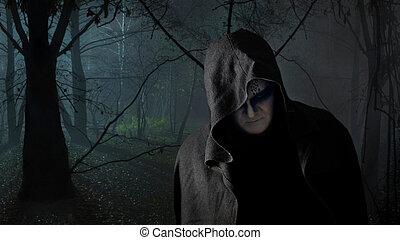 Black Monk - Black monk in the dark forest.