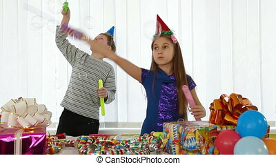 Children having fun at a birthday party - Children having...