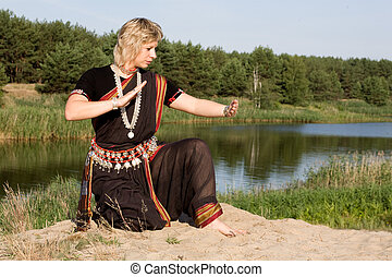 Indian dance - The woman dancer demonstrates Indian dance