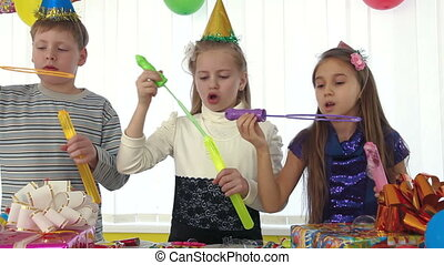 Children with soap bubbles at birthday party