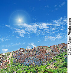 shining over the hill - sun shining over a typical Gallura...
