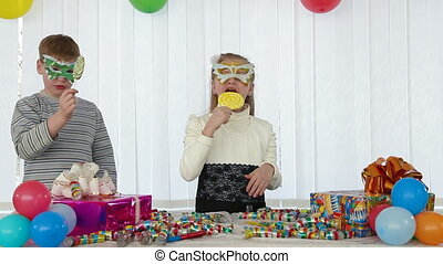 Children fun at birthday party - Children having fun licking...
