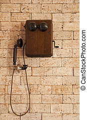 Antique telephone - Antique telephone on brick wall