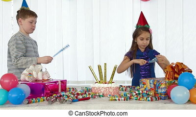 Children playing at birthday party