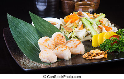 japanese cuisine. grilled shell fish on the background -...