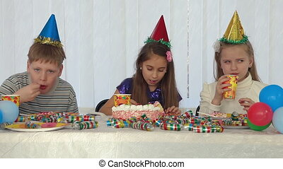Children celebrating birthday with cake