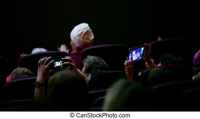 People applauding - People in auditorium applauding the...