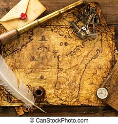 Sextant, spyglass and envelope on vintage map over wooden...