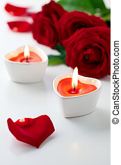 candles and red roses for Valentine's Day - Heart shaped...