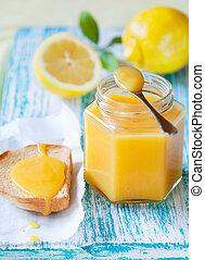 Lemon Curd - Homemade lemon curd on the toast and in a jar...