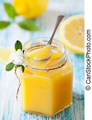 Lemon Curd - A jar of lemon curd with a spoon