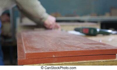 Man manufacturing wooden furniture