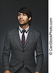 Handsome young business executive looking away - Portrait of...