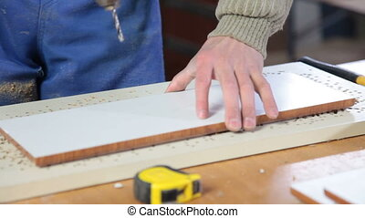 Woodworker assembling furniture in workshop