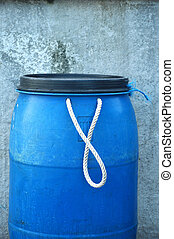 blue plastic barrel with white rope