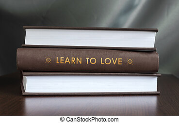 Learn to love. Book concept. - Books on a table and one with...