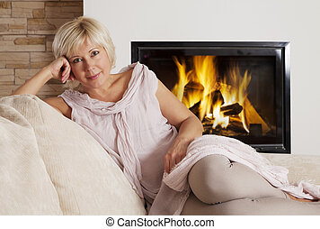 Portrait of attractive blond - Beautiful adult blond sitting...