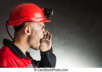 Angry coal miner shouting - Side view portrait of angry coal...