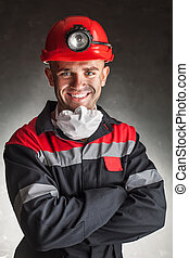 Smiling coal miner - Portrait of happy smiling coal miner...