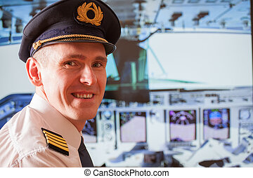 Airline pilot - Pilot captain wearing uniform with...