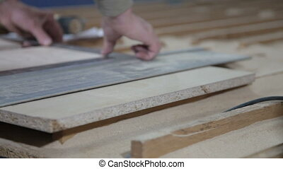 Sawing boards in workshop - Carpenter sawing boards in...