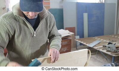Carpenter manufactures furniture