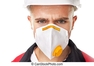 Serious worker wearing respirator - Closeup portrait of...