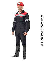 Full length portrait of young coal miner isolated on white...