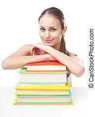 Smiling student girl with pile of books - Portrait of pretty...