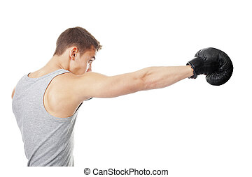 young boxer making punch - Side view portrait of young boxer...