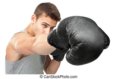 young boxer making punch - Portrait of young boxer making...
