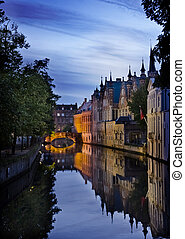 Bruges old Town - historic city center at sunset in Bruges,...