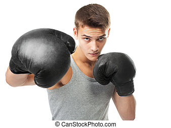 Boxer throwing a punch - Portrait of young boxer throwing a...