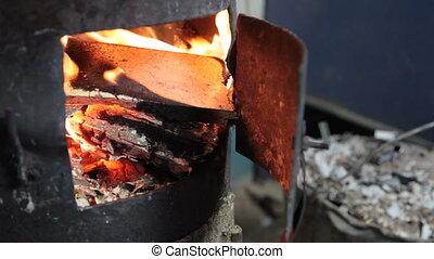 open door burning stove
