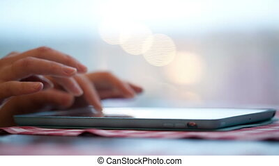 Woman typing on touchpad - Female hands typing on touchpad...