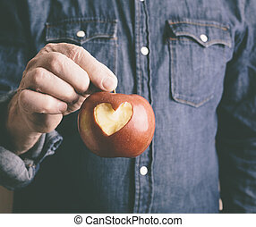 Valentine Day apple - red apple with hand of man
