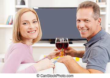 Happy to be together. Rear view of smiling mature couple...