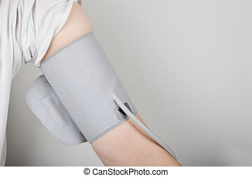measure blood pressure - male arm wrapped with blood...