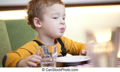 Boy at the table in cafe