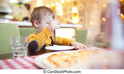 Little boy in cafe