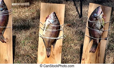 Cooking fish on a board