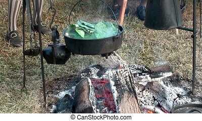 Cooking greens over a open fire