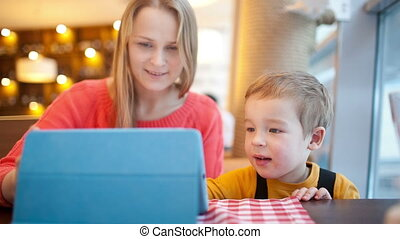 Mother and her son with touchpad