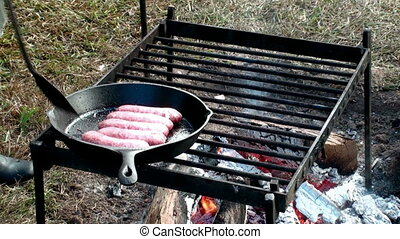 Cooking Sausage at a campfire