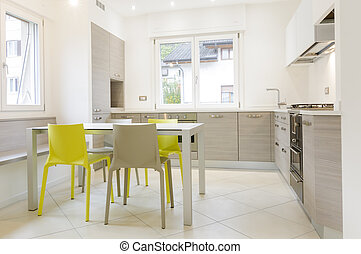 Modern kitchen interior with wooden cabinets, white table,...