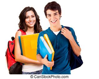 Young happy students - Two young happy students over white...