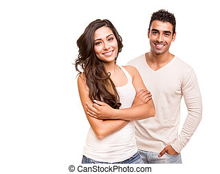 Couple posing over white background - Beautiful mixed race...