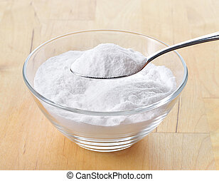 Close-up of baking soda on spoon. - Close-up of baking soda...