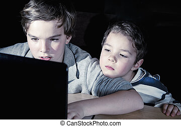 computer addiction - two brothers playing computer games...