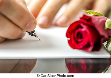 Man writing a letter to his sweetheart or lover for...